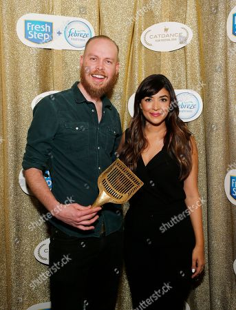 """New Girl"""" actress and cat lover Hannah Simone bestows the coveted Golden Litter Scoop to filmmaker Mike Thompson for his film """"The Purfect Patsy"""" at the Catdance Film Festival presented by new Fresh Step with the power of Febreze, in Park City, Utah"""
