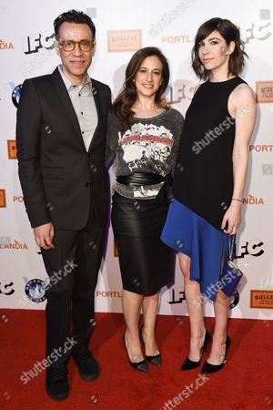 Fred Armisen, from left, Jennifer Caserta and Carrie Brownstein, arrive at Portlandia Season 5 Premiere Presented by Bulleit Bourbon at The Theatre at Ace Hotel in Los Angeles. The IFC comedy's fifth season, beginning Thursday, Jan. 8, features guest stars including Paul Simon and Steve Buscemi