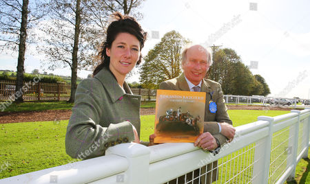 Stock Picture of Book illustrator, Michelle McCullagh and author, George Bingham pose with the book ÒWincanton Racecourse. The First 150 YearsÓ. - RACE 1 - 1:40 Wincanton - Jockey Club Catering Novices' Handicap Hurdle (Class 4) at Wincanton Racecourse, Wincanton, Somerset, England