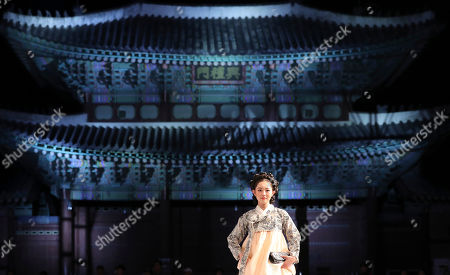 A model displays a creation by South Korean designer Lee Young-ae during a Hanbok fashion show to mark the Day of Hanbok 2017 at the Gyeongbok Palace, the main royal palace during the Joseon Dynasty, and one of South Korea's well known landmarks, in Seoul, South Korea