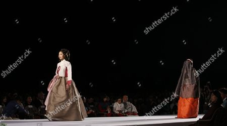 Models present South Korean traditional dresses called Hanbok by South Korean designer Lee Young-ae during the Day of Hanbok special event 'Gyeongbokgung Palace moonlight Hanbok fashion show' at the Gyeongbokgung Palace Special Outdoor Stage in Seoul, South Korea, 20 October 2017.