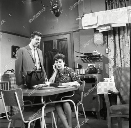 Philp Lowrie (as Dennis Tanner) and Pat Phoenix (as Elsie Tanner)