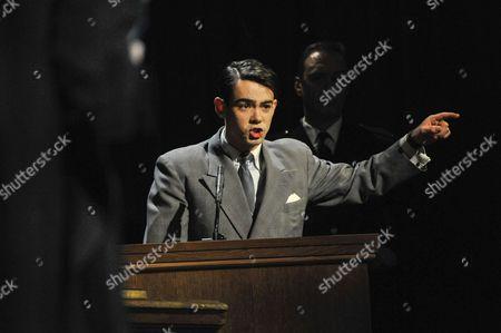 """Jack McMullen as Leonard Vole, the accused, in the witness stand. Photocall for """"Witness for the Prosecution"""", by Agatha Christie, directed by Lucy Bailey, at London County Hall"""
