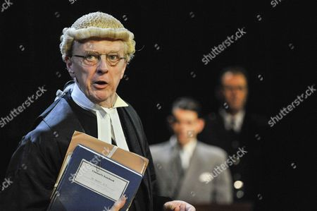 "Philip Franks as Mr Myers QC addresses Jack McMullen as Leonard Vole, the accused. Photocall for ""Witness for the Prosecution"", by Agatha Christie, directed by Lucy Bailey, at London County Hall"