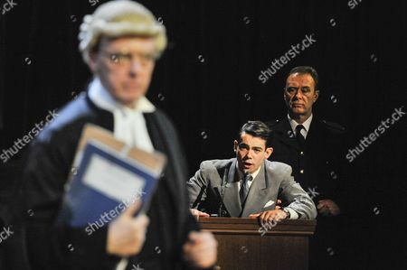 "Jack McMullen as Leonard Vole, the accused, in the witness stand. Photocall for ""Witness for the Prosecution"", by Agatha Christie, directed by Lucy Bailey, at London County Hall"