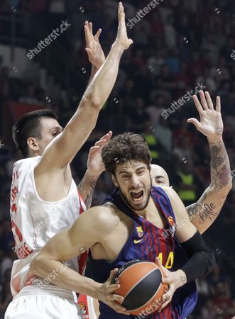 Ante Tomic (C) of Barcelona in action against Milko Bjelica (L) and Pero Antic (R) of Red Star during the Euroleague basketball match between Red Star and Barcelona in Belgrade, Serbia, 20 October 2017.