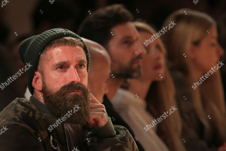 Stock Photo of Raul Meireles, an ex-soccer player watches a model displays a creation by Portuguese designer Diogo Miranda Collection during her runway show at the 41st edition of the Portugal Fashion Event in Oporto, Portugal, 20 October 2017.