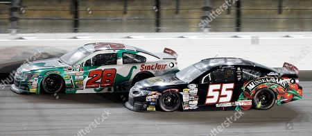 Michael Self (28) and Spencer Davis (55) race out of Turn 4 during an ARCA Racing Series auto race at Kansas Speedway in Kansas City, Kan., . Self won the race