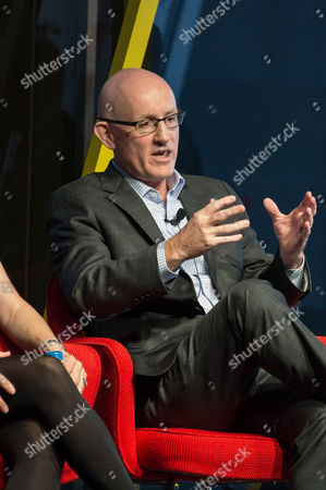 """Stock Photo of Jim Sullivan, Vice President, Discovery, AbbVie, is interviewed by Eddie Aruzza Emmy-Winning Host & Correspondent, WTTW Chicago, at the talk """"Redesigning Life: What Happens When We Live to 100?"""""""
