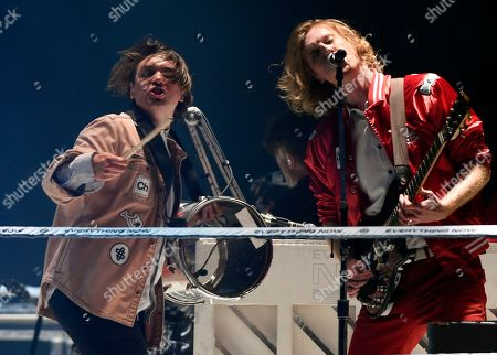 William Butler, Richard Reed Parry. William Butler, left, and Richard Reed Parry of Arcade Fire perform during the band's concert at The Forum, in Inglewood, Calif