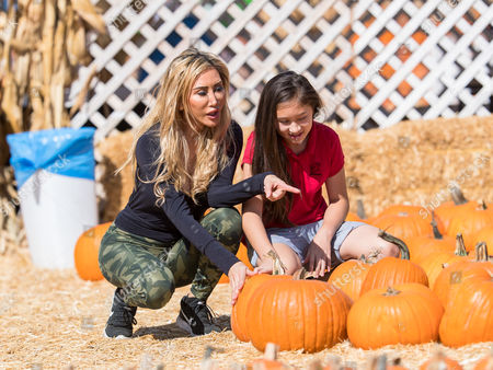 Stock Photo of Tess Broussard and her daughter Ava Hang are seen at at the pumpkin patch