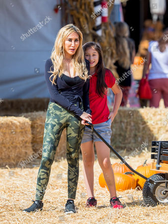 Tess Broussard and her daughter Ava Hang are seen at at the pumpkin patch