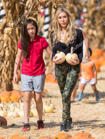 Stock Image of Tess Broussard and her daughter Ava Hang are seen at at the pumpkin patch