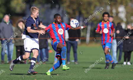 Joseph Hungbo of Crystal Palace U18 holds off Billy Mitchell of Millwall U18 during the U18 Professional Development League match between Millwall Academy v Crystal Palace Academy on October 21st 2017 at Millwall Training Ground, Bromley, England (