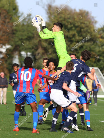 Sam Jackson of Millwall U18 saves the high ball during the U18 Professional Development League match between Millwall Academy v Crystal Palace Academy on October 21st 2017 at Millwall Training Ground, Bromley, England (