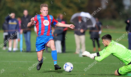 Sam Jackson of Millwall U18 saves at the feet of James Daly of Crystal Palace U18 during the U18 Professional Development League match between Millwall Academy v Crystal Palace Academy on October 21st 2017 at Millwall Training Ground, Bromley, England (