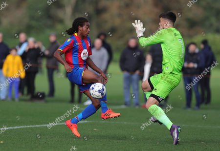 Sam Jackson of Millwall U18 saves from the boot of Francis Jno Baptiste of Crystal Palace U18 during the U18 Professional Development League match between Millwall Academy v Crystal Palace Academy on October 21st 2017 at Millwall Training Ground, Bromley, England (