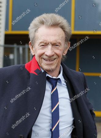 Stock Image of Former Huddersfield and Manchester United player Denis Law arriving at the ground, during the Premier League match between Huddersfield Town and Manchester United at the John Smiths Stadium, Huddersfield