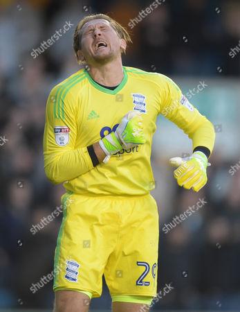 Birmingham City Goalkeeper Tomasz Kuszczak reacts after being kicked in the wrist.