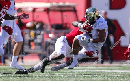 Purdue Boilermakers running back Markell Jones (8) gets taken down by Rutgers Scarlet Knights linebacker Trevor Morris (15) during the first half of an NCAA football game between the Purdue Boilermakers and the Rutgers Scarlet Knights at the High Point Solutions Stadium in Piscataway, NJ