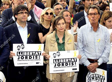 Catalan regional president Carles Puigdemont, Carme Forcadell and Artur Mas i Gavarro