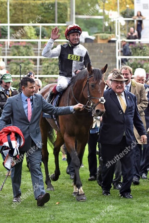 , Ascot, GB, Cracksman with Frankie Dettori up and owner Anthony Oppenheimer (right) after winning the Champion Stakes.