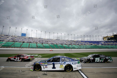 Stock Picture of Corey LaJoie Jamie McMurray Reed Sorenson. Driver's Corey LaJoie (23) Jamie McMurray (1) and Reed Sorenson (15) wait their turn to get on the track as storm clouds gather during practice for Sunday's NASCAR Cup Series auto race at Kansas Speedway in Kansas City, Kan