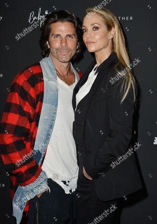 Stock Photo of Elizabeth Berkley and Greg Lauren