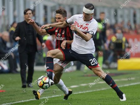 Fabio Borini challenges for the ball with Aleandro Rosi