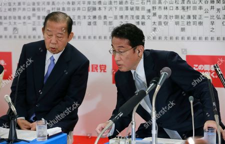 Stock Picture of Fumio Kishida, Toshihiro Nikai. The Liberal Democratic Party (LDP) chairman of executive Council Fumio Kishida, right, and Secretary General Toshihiro Nikai watches a TV monitor during ballot counting for the lower house elections at the party headquarters in Tokyo, . Japanese media projected shortly after polls closed that Prime Minister Shinzo Abe's ruling coalition would win a clear majority in national elections