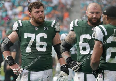 Wesley Johnson, Brian Winters, Matt Forte. New York Jets center Wesley Johnson (76) and offensive guard Brian Winters (67), listens to running back Matt Forte (22) on the sidelines,during the second half of an NFL football game against the Miami Dolphins, in Miami Gardens, Fla