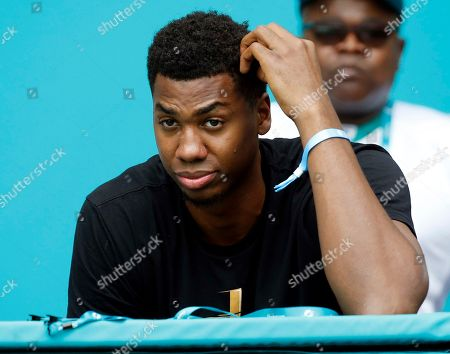 Miami Heat player Hassan Whiteside watched the game during the second half of an NFL football game against the New York Jets, in Miami Gardens, Fla