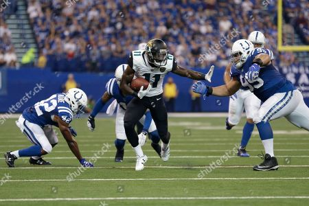 Johnathan Hankins, Marqise Lee. Jacksonville Jaguars wide receiver Marqise Lee (11) tries to hold off Indianapolis Colts defensive end Johnathan Hankins (95) during the first half of an NFL football game in Indianapolis