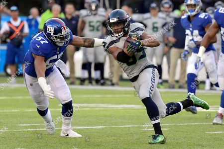 Doug Baldwin, Keenan Robinson. Seattle Seahawks' Doug Baldwin, right, tries to evade New York Giants' Keenan Robinson during the first half of an NFL football game, in East Rutherford, N.J
