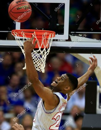 Kansas forward Billy Preston (23) rebounds during the first half of an exhibition NCAA college basketball game against Missouri in Kansas City, Mo