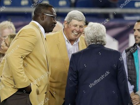 Andre Tippett, John Hannah, Robert Kraft. Former New England Patriots legends Andre Tippett, left, and John Hannah, center, talk to team owner Robert Kraft before an NFL football game between the Patriots and the Atlanta Falcons, in Foxborough, Mass