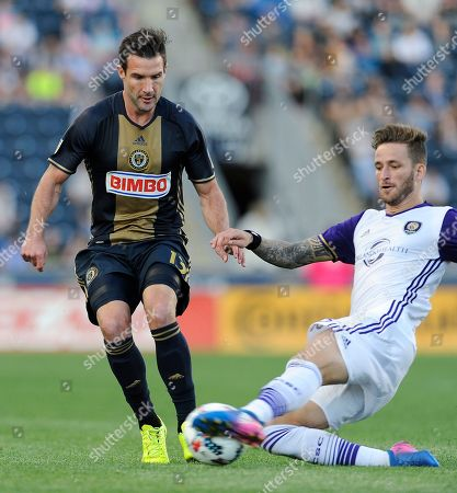 Leo Pereira, Chris Pontius. Orlando City SC defender Leo Pereira, right, steals the ball away from Philadelphia Union forward Chris Pontius in the second half of an MLS soccer match, in Chester, Pa. The Union won 6-1