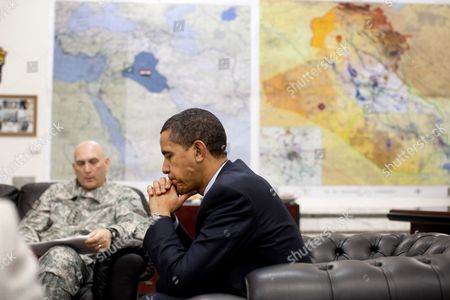 US President Barack Obama meets with General Raymond T. Odierno, Commanding General, Multi-National Force-Iraq, during the President's visit with U.S. troops at Camp Victory, Baghdad, Iraq