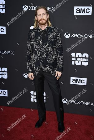Austin Amelio attends the Season Eight premiere screening of AMC's 'The Walking Dead'