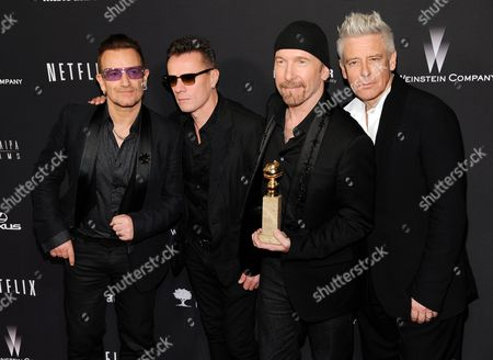 """Stock Photo of From left, Bono, Larry Mullen, Jr., The Edge and Adam Clayton, of the Irish band U2, winners of the award for best original song for """"Ordinary Love"""" from the film """"Mandela: Long Walk to Freedom,"""" arrive at The Weinstein Company's Golden Globes after party at the Beverly Hilton Hotel in Beverly Hills, Calif. U2, Pharrell Williams, Karen O and Idina Menzel are slated to perform the nominated original songs at the 86th Academy Awards on . Bette Midler and Pink are also set to perform"""