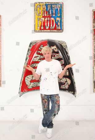"""Artist Peter Tunney of NYC poses with his art during his """"Lost & Found"""" Art Basel Miami exhibition on Friday, Nov., 29, 2013 at the Peter Tunney Experience inside the Wynwood Walls in Miami, FL"""