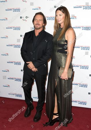 Eddie Vedder, Jill McCormick. Eddie Vedder, left, of the band Pearl Jam with his wife Jill McCormick arrive at the Kennedy Center for the Performing Arts for the 20th Annual Mark Twain Prize for American Humor presented to David Letterman, in Washington, D.C