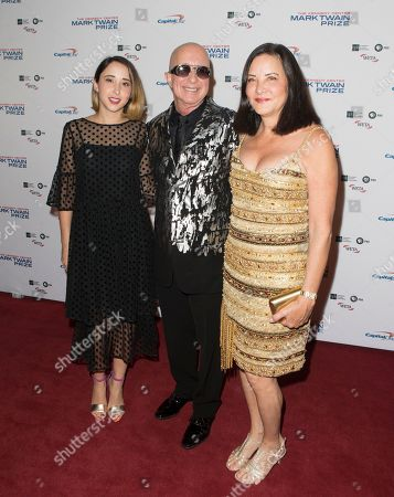 Stock Photo of Victoria Lily Shaffer, Paul Shaffer, Cathy Vasapoli. Paul Shaffer, center, with his daughter Victoria Lily Shaffer, left, and wife Cathy Vasapoli arrive at the Kennedy Center for the Performing Arts for the 20th Annual Mark Twain Prize for American Humor presented to David Letterman, in Washington, D.C