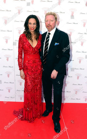 Lily and Boris Becker pose for photographers at Gabrielle's Angels Foundation UK Gala in London on