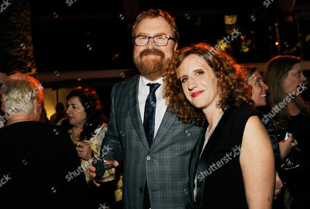 """R.J. Cutler, left, director of """"If I Stay,"""" poses with Gayle Forman, author of the novel upon which the film was based, at the after party for the film, in Los Angeles"""