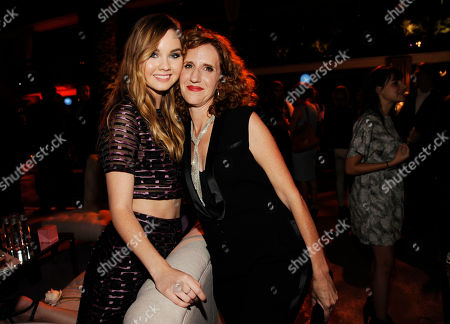 """Stock Picture of Liana Liberato, left, a cast member in 'If I Stay,"""" poses with Gayle Forman, author of the novel upon which the film was based, at the after party for the film, in Los Angeles"""