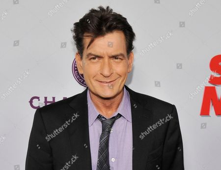 "Charlie Sheen, a cast member in ""Scary Movie V,"" poses at the Los Angeles premiere of the film at the Cinerama Dome in Los Angeles. Scottine Ross, a porn star who performed under the name Brett Rossi, sued the actor, for assault, battery and intentional infliction of emotional distress claims. Her lawsuit states she and Sheen had sex five times before the actor told her he was HIV positive"