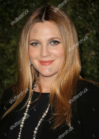 Drew Barrymore arrives at the Chanel Dinner celebrating the release of Drew Barrymore's new book 'Find It In Everything' at Chanel Boutique in Beverly Hills, Calif. The actress, 39, and her art advisor husband, Will Kopelman, 36, have welcomed their second daughter. Frankie Barrymore Kopelman was born, confirms Barrymore's rep Chris Miller