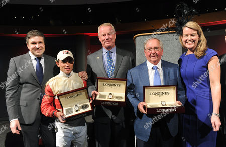 "Jennifer Judkins, right, and Juan-Carlos Capelli, left, both of Longines, award owner Stuart S. Janney III, center, trainer Claude ""Shug"" McGaughey III, second right, and jockey Joel Rosario, with their Longines timepieces after their horse Orb won the 139th Kentucky Derby, in Louisville, Ky. Longines, the Swiss watchmaker known for its famous timepieces, is the Official Watch and Timekeeper of the 139th annual Kentucky Derby"