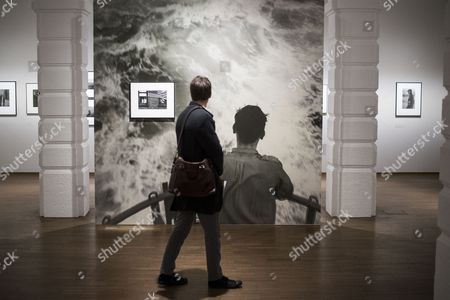A visitor looks at a photograph of Swiss-born photographer Robert Frank during a press preview of the exhibition 'Robert Frank' at the Galleries of Photography of the Albertina museum in Vienna, Austria, 23 October 2017. The exhibition Robert Frank will be open for public from 25 October 2017 until 21 January 2018.